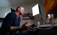 Grant Stinchfield, a former KXAS-TV reporter, does a live interview on National Rifle Association TV via Skype at his home in Dallas.(Jae S. Lee/Staff Photographer)