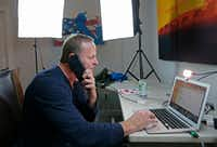 Former KXAS-TV reporter Grant Stinchfield talks on his cellphone in preparation for a live spot on National Rifle Association TV (NRA TV) via Skype at his Dallas home. Stinchfield hosts an eponymous show on the streaming channel and delivers live news updates and interviews at the top of the hour from 8 a.m. to noon Central time on weekdays.(Jae S. Lee/Staff Photographer)