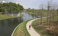 Farmers Branch Creek  flows though Vitruvian Park in Addison.(Louis DeLuca/Staff Photographer)