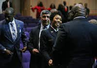 Dallas Police Chief U. Renee Hall greets Bishop T.D. Jakes after her swearing-in. (Andy Jacobsohn/Staff Photographer)