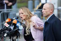 Adult-film actress Stephanie Clifford, also known as Stormy Daniels, speaks outside U.S. Federal Court with her lawyer Michael Avenatti in Lower Manhattan, New York. (EDUARDO MUNOZ ALVAREZ/AFP/Getty Images)