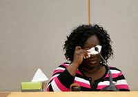 Jordan Edwards' mother, Charmaine Edwards, wipes away tears Thursday during a court hearing for Roy Oliver, the former cop who is charged with murder in the boy's death.(Rose Baca/Staff Photographer)