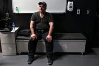 David Colbath rests after practicing shooting using an active shooter simulation video for the first time in the Firearms Training Simulator at the Center for the Intrepid at Brooke Army Medical Center on March 9. (Lisa Krantz/San Antonio Express-News)