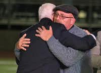 United States Vice President Mike Pence embraces First Baptist Church of  Sutherland Springs pastor Frank Pomeroy after the vice president's remarks at a memorial service at the Floresville High School football stadium in Floresville, Texas.(Louis DeLuca/Staff Photographer)