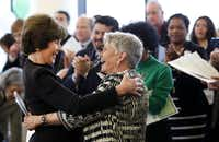 Former first lady Laura Bush hugs Dr. Harryette B. Ehrhardt, former Dallas ISD principal and trustee, and retired state legislator, in 2013.(Lara Solt/Staff Photographer)