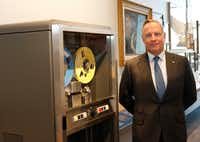 Ross Perot Jr., chairman of the Perot Group and Hillwood, stands next to the IBM 729 Magnetic Tape Drive c. late 1950s-late 1960s at company headquarters. The drive was an iconic mass storage system, and as IBM's top salesman in the Dallas region, Ross Perot Sr. sold many of these exact models. (David Woo/Staff Photographer)