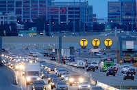 "Ten years ago, the North Texas Tollway Authority was unpopular. Now the ire of some motorists falls upon TxDOT and its relationship with private investors who helped build ""managed lanes,"" where prices fluctuate and can go much higher than NTTA prices.(Tom Fox/Staff Photographer)"