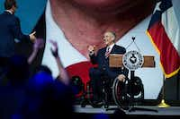 Texas Gov. Greg Abbott takes the stage to address the NRA-ILA Leadership Forum at the Kay Bailey Hutchison Convention Center.(Smiley N. Pool/Staff Photographer)