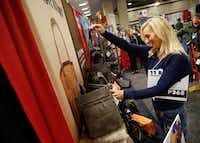 Rebecca Schneider looks at a concealed carry handbag at the NRA Annual Meeting & Exhibits at Kay Bailey Hutchison Convention Center in Dallas on Friday, May 4, 2018. (Rose Baca/The Dallas Morning News)(Rose Baca/Staff Photographer)