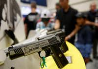 A Thompson Trump Custom 1911 on display at the NRA Annual Meeting & Exhibits at Kay Bailey Hutchison Convention Center in Dallas on Friday.(Rose Baca/Staff Photographer)