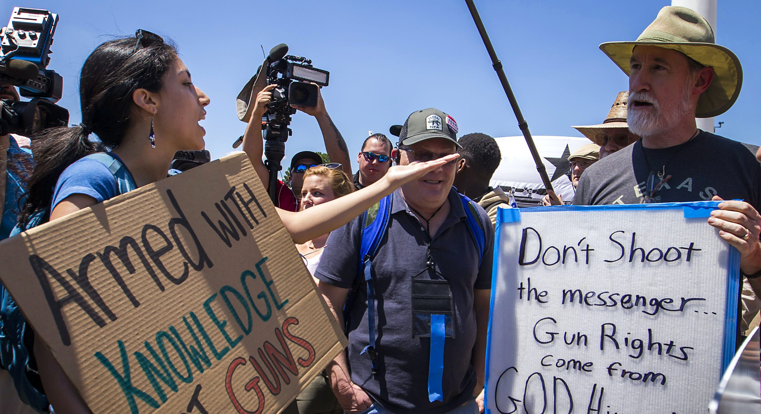 Gun control advocates face off with armed activists in ...