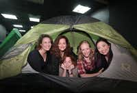 From left: Jennifer Kuenzer, Jessica Cavanagh, Marianne Galloway, Danielle Pickard and Renee Dessommes on the set of Cavanagh's play,  <i>Self Injurious Behavior</i>.  The women say the play resonates with their experience of being moms. Theatre Three presents a fully produced workshop in their Theatre Too space May 17-June 10.  (Jason Janik/Special Contributor)