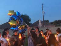 "<p><span style=""font-size: 1em; background-color: transparent;"">James Gonzalez's family -- stepmother Stephanie Gonzalez, stepbrother Mike Lozano and sister Alanna Bouvier -- release balloons in his honor on Sunday at Kenwood Heights Park in Rowlett.</span></p>(Dallas Morning News/Julieta Chiquillo)"