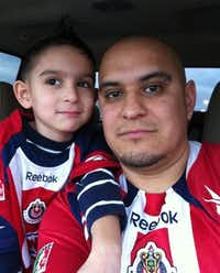James Gonzalez and his father, Policarpo Gonzalez-Flores, wore matching jerseys in this 2011 photo.(Facebook)