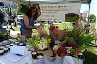 At Coppell Farmers Market, Sue Newhouse and husband Brian O'Dwyer sell berry plants, jams, infused vinegars and cut flowers from Aunt Sue's Barn near Ponder. (Kim Pierce/Special Contributor)