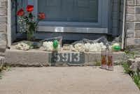 A small memorial is starting to form on the front step of 5913 Mimosa Lane in Rowlett, Texas Monday, May 7, 2018. Policarpo Gonzalez-Flores, 40, shot his 11-year-old son,  James Gonzalez, before killing himself on Saturday, May 5, 2018, according to authorities. Gonzalez-Flores' wife, Stephanie Gonzalez, had been on the phone with her husband before she called 911. The two had been arguing about marital issues earlier that night. (Ron Baselice/The Dallas Morning News)(Ron Baselice/Staff Photographer)