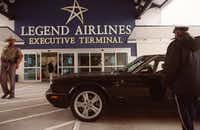 Legend Airlines security informs a person arriving at the carrier's Dallas Love Field gate on Dec. 2, 2000, that the airline had voluntarily suspended scheduled service while attempting to secure capital to fund operations.(2000 File Photo/Vernon Bryant)
