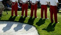 "<p>Tournament volunteers clad in the signature red slacks identifying them as <span style=""font-size: 1em; background-color: transparent;"">Salesmanship Club members </span><span style=""font-size: 1em; background-color: transparent;"">stand at attention during the 2006 Byron Nelson Classic trophy presentation.</span></p>(Guy Reynolds/2006 File Photo)"