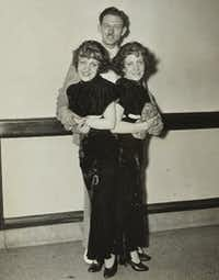 Violet and Daisy Hilton pose with Violet's fiance, Maurice Lambert. The couple applied for marriage licenses in 21 states but were denied on moral grounds. Violet and Daisy would both eventually wed, but neither union lasted.(1934 File Photo/<p>KRT/Akron Beacon-Journal</p>)