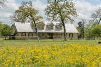 The Champion Ranch includes a main house, bunk house and other barns and cabins.(Icon Global)
