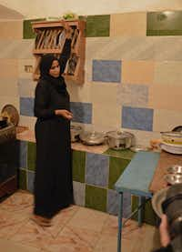 Ashraf Sahloul€™'s wife, Nawal, prepares a meal for a G Adventures tour group. (Marilyn Jones)