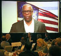 A video showing AT&T Chief Compliance Officer David Huntley talking about receiving an ethics award is played at the 2018 Greater Dallas Business Ethics Award luncheon. Huntley said his company is on the right track ethically but that was called into question a few hours later when AT&T's payments to President Trump's personal lawyer were revealed.(Louis DeLuca/Staff Photographer)
