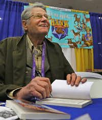 John Erickson, author of the Hank the Cowdog books, signs books at the Texas Library Association conference held at the Kay Bailey Hutchison Convention Center in downtown Dallas.(Louis DeLuca/Staff Photographer)