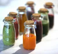 Natural food dyes can come in powder or liquid form. (Louis DeLuca/Staff Photographer)