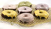 Doughnuts are topped with a glaze made with natural food coloring.(Louis DeLuca/Staff Photographer)