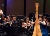 Flutist David Buck (left) and harpist Emily Levin perform Mozart's Concerto in C major for flute, harp and orchestra K. 299, with the Dallas Symphony Orchestra, led by music director Jaap van Zweden, at Moody Performance Hall on May, 10, 2018. (Rex C. Curry/Special Contributor)