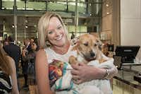 "<p><span style=""font-size: 1em; background-color: transparent;"">Kristen Greenberg held an adoptable pup from the SPCA of Texas.</span></p>(Thomas Garza  Photography)"
