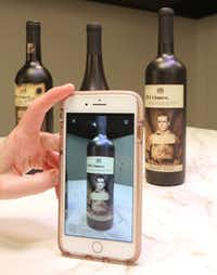 With the aid of AR technology, some wine bottles, like these 19 Crimes bottles, now have labels that come to life via your smartphone. (Louis DeLuca/Staff Photographer)
