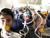 In this April 17, 2018 photo provided by Marty Martinez, Martinez, left, appears with other passengers after a jet engine blew out on the Southwest Airlines Boeing 737 plane he was flying in from New York to Dallas. (Marty Martinez via AP)(Marty Martinez/AP)