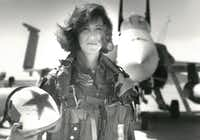 In a photo provided by the U.S. Navy, Lt. Tammie Jo Shults with her F/A-18A jet in 1992. Shults, one of the Navy's first female fighter pilots, was in command of Southwest Airlines Flight 1380 when its engine exploded on April 17, 2018; for the next 40 minutes, she maneuvered the plane safely to an emergency landing in Philadelphia. (Thomas P. Milne/U.S. Navy via The New York Times) -- FOR EDITORIAL USE ONLY --(THOMAS P. MILNE/NYT)