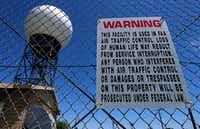 A warning sign is seen on the fence of a Doppler weather radar station near the Cypress Waters development at the corner of Ranch Trail and Van Zandt Drive in Dallas.(Jae S. Lee/Staff Photographer)