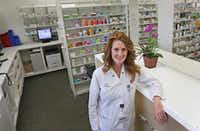"Pharmacist Julie Caldwell said the Walgreens Community Pharmacy at 7859 Walnut Hill Lane in Dallas looks ""completely different"" from other Walgreens.(Louis DeLuca/Staff Photographer)"