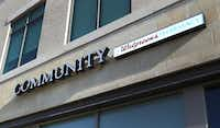 "The logo at the Walgreens Community Pharmacy at 7859 Walnut Hill Lane in Dallas, emphasizes ""community"" with the company's traditional signature smaller and off to the side.(Louis DeLuca/Staff Photographer)"