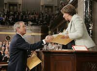 US President George W. Bush greets Speaker of the House Nancy Pelosi during the 2007 State of the Union address. (Larry Downing/AFP/Getty Images)