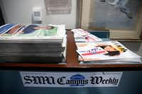 A stack of <i>SMU Campus Weekly </i>newspapers, produced by <i>The Daily Campus</i>, and SMU Look sits outside the Student Media Co. office at SMU in Dallas on Monday, May 14, 2018. SMU's independent student media company was set to be dissolved, forcing its student newspaper <i>The Daily Campus</i> under the control of the school's journalism department. (Rose Baca/Staff Photographer)