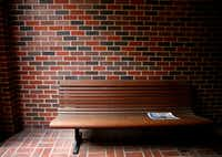 An issue of the <i>SMU Campus Weekly</i>, produced by <i>The</i> <i>Daily Campus</i>, is left on a bench outside the journalism complex at the Umphrey Lee Center at SMU in Dallas on Monday, May 14, 2018. (Rose Baca/Staff Photographer)
