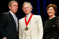 President Bush, left, poses with author Tom Wolfe, center, and first lady Laura Bush during the National Endowment for the Arts National Medal Awards ceremony at Constitution Hall in Washington.(PABLO MARTINEZ MONSIVAIS/AP)
