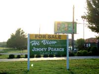 Everyone driving to or from the Nelson this weekend will see Jimmy Poarch's giant sign on the former used-car lot on Loop 12.(Robert Wilonsky/Staff writer)