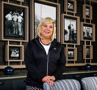 "Lori Lee, AT&T's international & global   marketing officer, said the telecom company wanted the Byron Nelson tournament to have a new venue that would ""take it to the next level."" She is a member of the Trinity Forest Golf Club, which has a room decorated with black-and-white photos of golf legend Byron Nelson.(Tom Fox/Staff Photographer)"