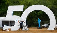 Brandon Barnes puts up a sign before the AT&T Byron Nelson kicks off at Trinity Forest Golf Club. The tournament, which is celebrating its 50th anniversary, has a new home in southern Dallas.(Nathan Hunsinger/Staff Photographer)