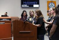 Community members gather around Mandy Wilkerson as she speaks about council member La'Shadion Shemwell's accusation that her husband, a McKinney police officer, committed racial profiling while pulling Shemwell over for alleged speeding last week. (Janik/Special Contributor)