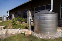 Two 1,600-gallon tanks are used to catch and recycle rainwater for landscaping.(Stewart F. House/Special Contributor)