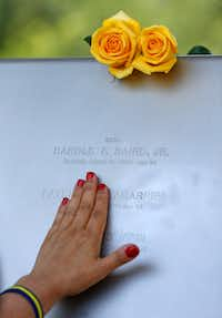 Isabel Zamarripa touches the engraved name of her nephew Patrick Zamarripa, one of five officers killed in the downtown ambush in 2016. (Jae S. Lee/Staff Photographer)