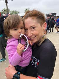 Brandi Grissom Swicegood, an Austin writer, and her daughter, Adaline, at the end of the 2018  Ironman Texas 70.3 in Galveston. She is capturing life's moments as she balances family and relationships while training to become a professional triathlete.(Travis Swicegood)
