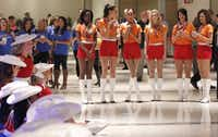 Women dressed in the original outfits of Southwest Airlines flight attendants watch the Kilgore Rangerettes perform as the Wright amendment ends and Dallas Love Field is opened to non-stop flights,  at Love Field in Dallas, Texas, on Oct. 13, 2014.(Michael Ainsworth/Staff Photographer)