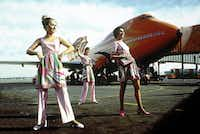 Braniff flight attendants model their Pucci uniforms on the tarmac. ( / )